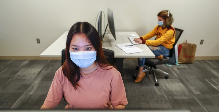 students in masks using the computer labs and social distancing