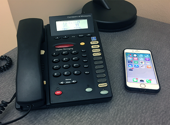 landline telephone and cellphone on a desk